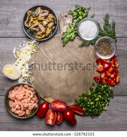 Cooking mussels shrimp tomatoes onions parsley dill garlic seasoning salt on a cutting board frame on wooden background top view close up space for text - stock photo