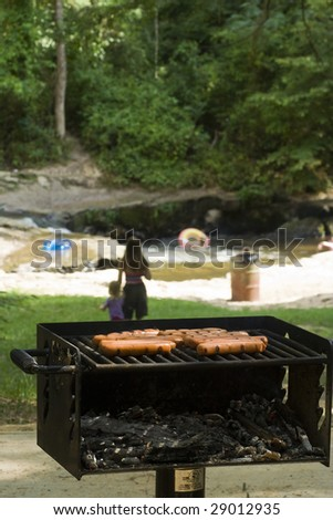 Cooking on grill for weekend picnic - stock photo