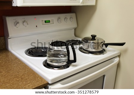 Cooking on the electric ring spiral stove top - stock photo