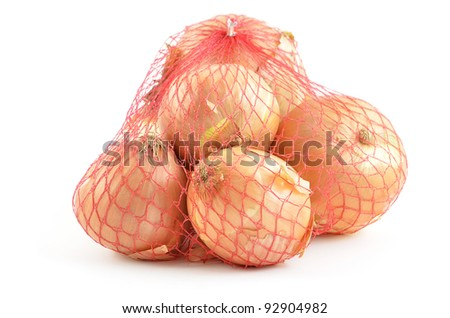 Cooking onions in red mesh bag isolated on white background