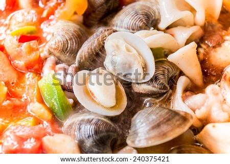 cooking paella, typical spanish food - stock photo