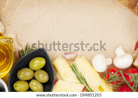 Cooking paper for copy space and various food - stock photo