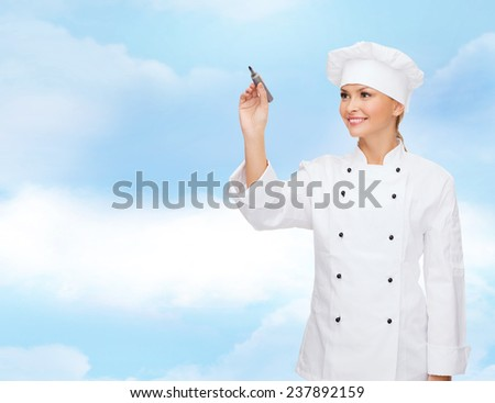 cooking, people, advertisement and concept - smiling female chef, cook or baker with marker writing something on virtual screen over blue cloudy sky background - stock photo