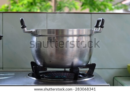 Cooking pots with steam. - stock photo