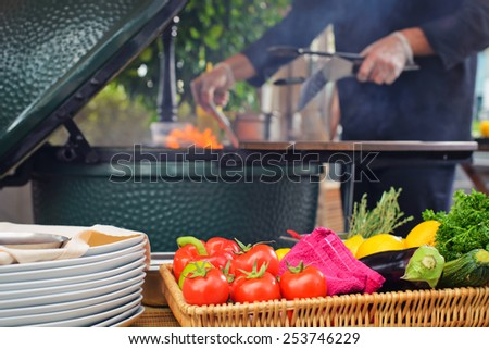 cooking process dorado fish on the grill braziers focus in the foreground on the prepared vegetables to bake - stock photo