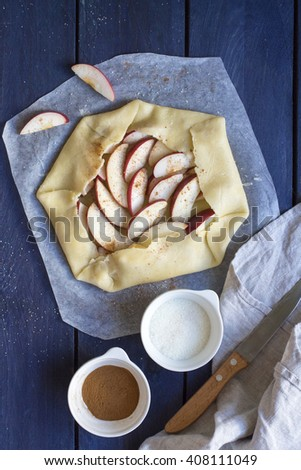 Cooking process of galetta (biscuit) with apples on wooden background. Apple pie with cinnamon.  - stock photo