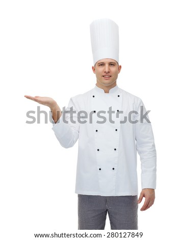 cooking, profession, advertisement and people concept - happy male chef cook showing something on empty palm - stock photo