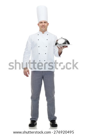 cooking, profession and people concept - happy male chef cook holding cloche - stock photo