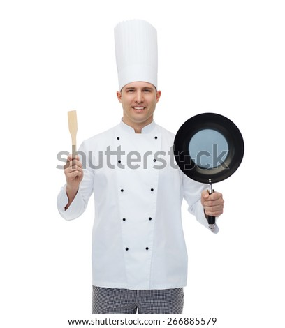 cooking, profession and people concept - happy male chef cook holding frying pan and spatula - stock photo