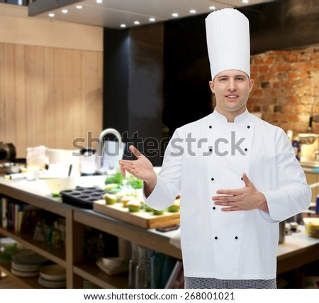 cooking, profession and people concept - happy male chef cook inviting - stock photo