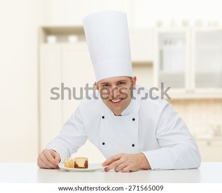 cooking, profession, haute cuisine, food and people concept - happy male chef cook with dessert over kitchen background - stock photo