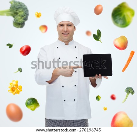 cooking, profession, technology, vegetarian diet and people concept - happy male chef cook showing tablet pc computer black blank screen - stock photo