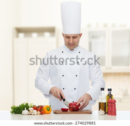 cooking, profession, vegetarian, food and people concept - happy male chef chopping pepper over kitchen background - stock photo