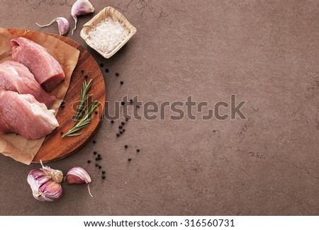 Cooking. Raw meat on the table - stock photo
