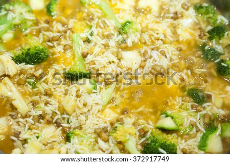 Cooking rice with broccoli and selective focus