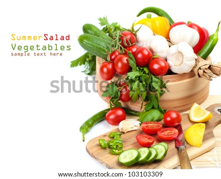 Cooking salad, fresh vegetables - cherry tomatoes, cucumbers, garlic and herbs on a white background with copy space