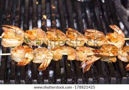 cooking shrimp on the grill in the restaurant - stock photo