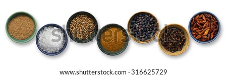 Cooking spices in a row on white background