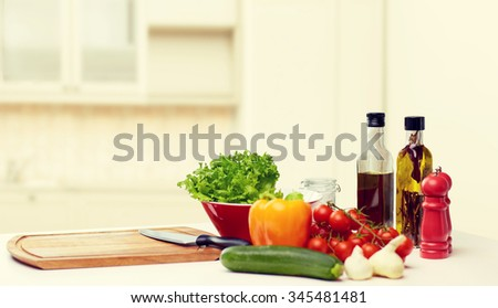 cooking, still life, food and healthy eating concept - fresh ripe vegetables, spices and kitchenware on table over kitchen background - stock photo