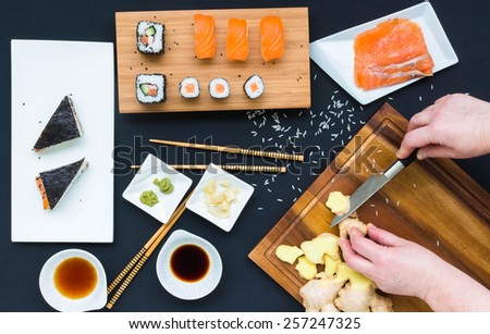 Cooking sushi, hands - mooving blur, top view - stock photo
