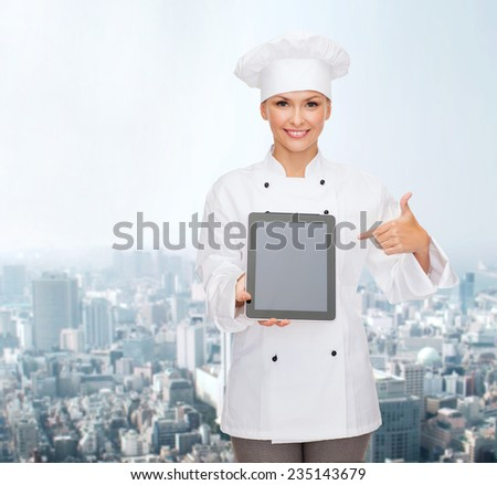 cooking, technology and food concept - smiling female chef, cook or baker with tablet pc computer pointing finger to blank screen over city background - stock photo