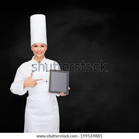 cooking, technology and food concept - smiling female chef with tablet pc computer blank screen - stock photo