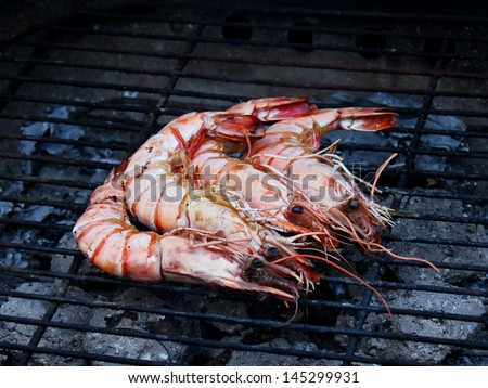 Cooking tiger prawns grilled. Close-up. Background. Outdoor.