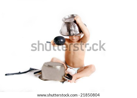 cooking toddler in colander hat over white - stock photo
