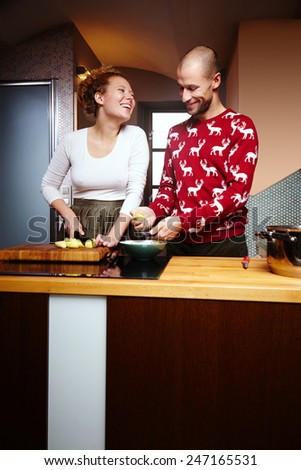 Cooking together and happy - stock photo