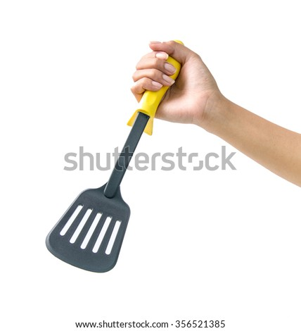 Cooking tools in hand on a white background
