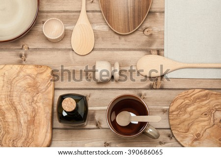 Cooking Tools. Kitchenware. Olive Wood Chopping Board. Top View. Wooden Table. - stock photo