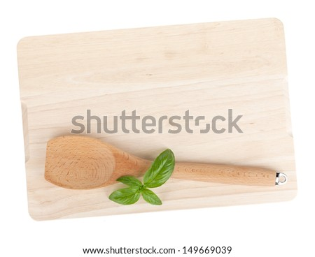 Cooking utensil and basil leaves over cutting board. Isolated on white background - stock photo