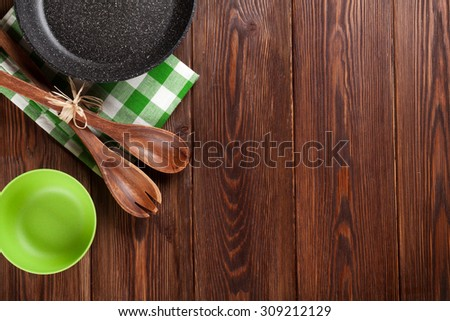 Cooking utensil on wooden table. Top view with copy space - stock photo