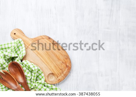 Cooking utensils on wooden table. Top view with copy space - stock photo