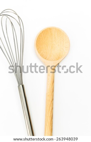 cooking whisk with wooden spoon isolated on white background