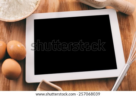 Cooking with digital tablet - stock photo
