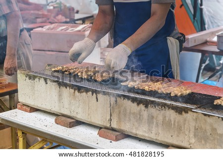 Cooking Yakitori on stall in Japan