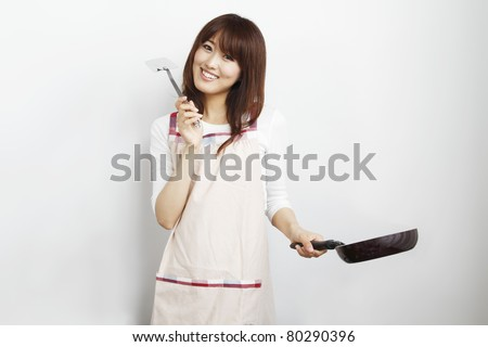 Cooking young woman - stock photo
