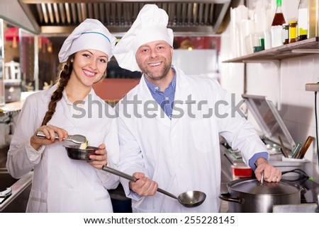 cooks cooking at professional kitchen in the  take-away  restaurant - stock photo