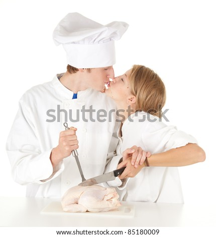 cooks team in white uniforms preparing raw chicken, series - stock photo