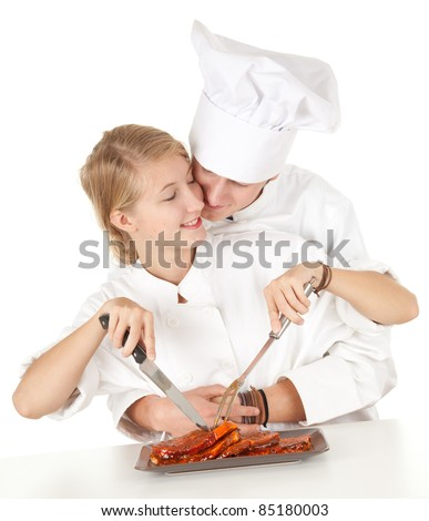cooks team in white uniforms preparing raw meat, series - stock photo