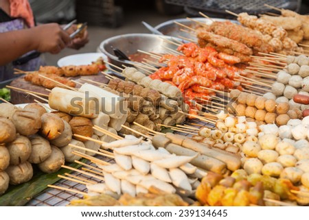 cookshop in Bangkok, Thailand, with various skewers and other meat - stock photo