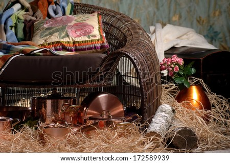 cookware near wicker chairs with cushions of hay - stock photo