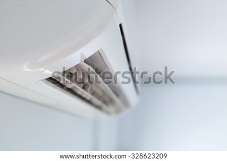 cool air conditioner system on white wall room - stock photo
