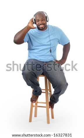 Cool and casual college stduent listening to music - stock photo