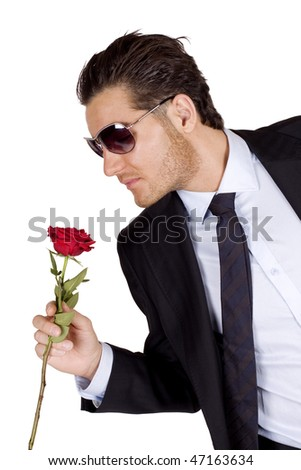 Cool and romantic man with a rose - stock photo