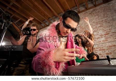 Cool Asian DJ at a 1970s Disco Music Party - stock photo