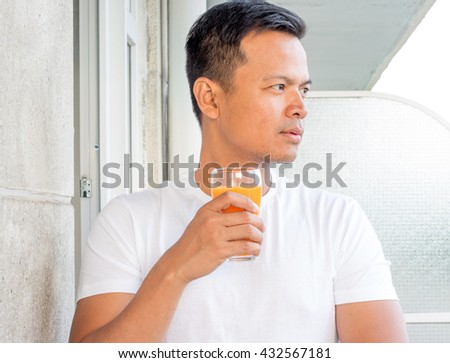 cool asian man drinking a juice