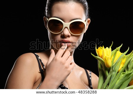 Cool beautiful woman with yellow flowers