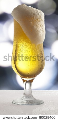 Cool Beer on a luxury glass against abstract lights background - stock photo